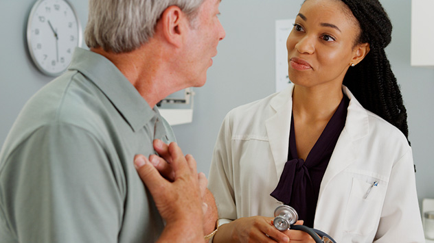 Physician assistant interacting with a patient