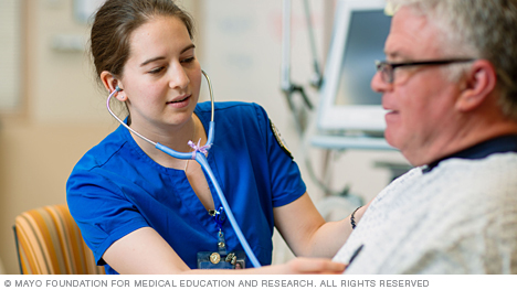 Photo of Mayo Clinic respiratory care student examining a patient