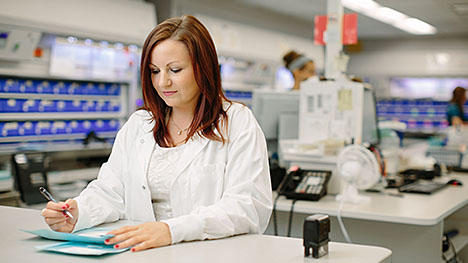 Photo of a Mayo Clinic pharmacist taking notes