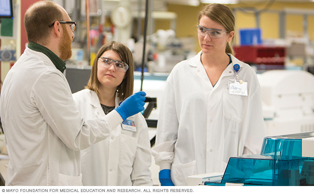 Photo of three Mayo medical laboratory science students in a lab
