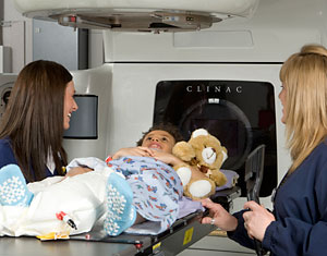 Photo of two radiation therapists and a patient