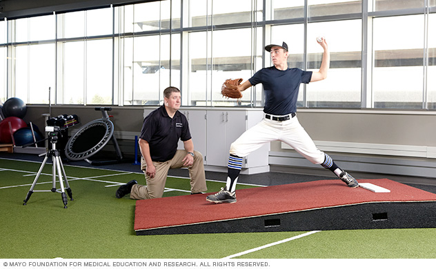 Photo of Mayo Clinic sports physical therapist with a baseball player