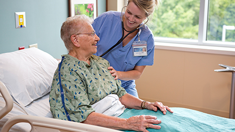 Photo of a Mayo Clinic nurse talking with a patient