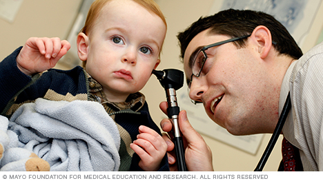 Photo of Mayo Clinic family medicine physician examining child