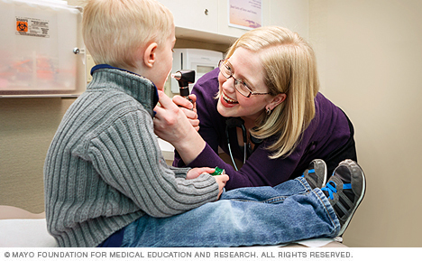 Photo of family medicine physician examining child at Mayo Clinic Health System in Eau Claire