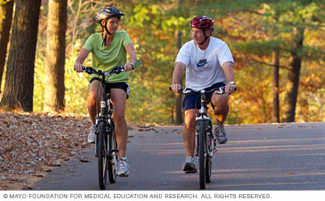 Photo of man and woman biking in Eau Claire