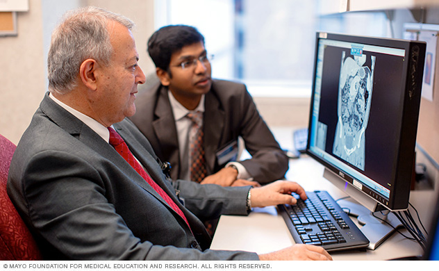 Photo of gastroenterologist Michael Camilleri, M.D., reviewing research findings with fellow Rajesh Krishnamoorthi, M.B.B.S.