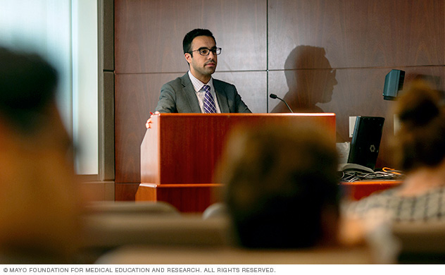 Photo of fellow Badr F. Al Bawardy, M.D., giving a presentation to staff and fellows