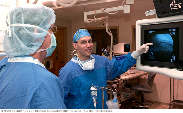 Photo of two Mayo physicians in the Cardiac Catheterization Laboratory