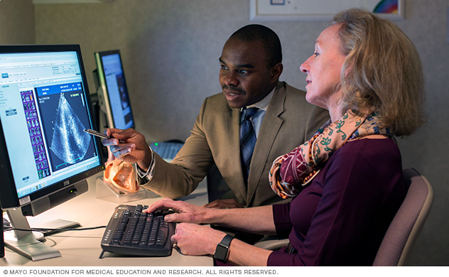 Photo of Heidi M. Connolly, M.D., reviewing a transthoracic echocardiogram with Alexander C. Egbe, MBBS