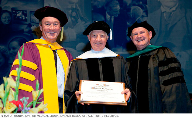 Photo of 2014 Honorary Degree Recipient William (Bill) W. George, with John H. Noseworthy, M.D., and Mark A. Warner, M.D.