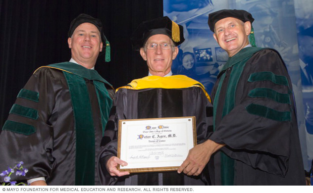 Photo of 2015 Honorary Degree Recipient Peter C. Agre, M.D., with Wyatt W. Decker, M.D., and Mark A. Warner, M.D.