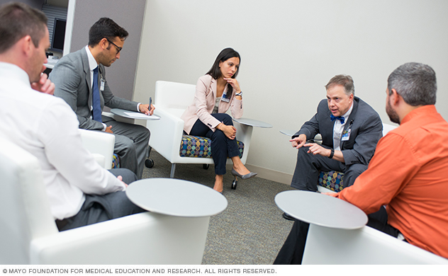 Photo of Mayo Clinic Adult Neurology residents and faculty in a small group discussion