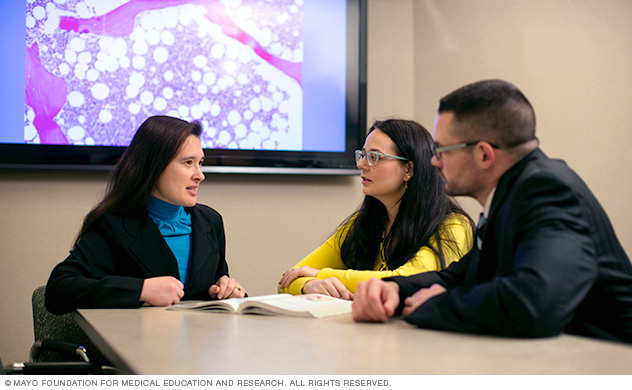 Photo of Mayo Clinic Medical Scientist Training Program students with a mentor