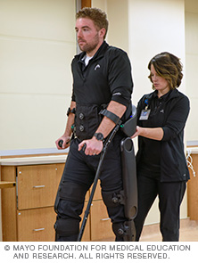 Mayo Clinic physical therapist helping a patient walk