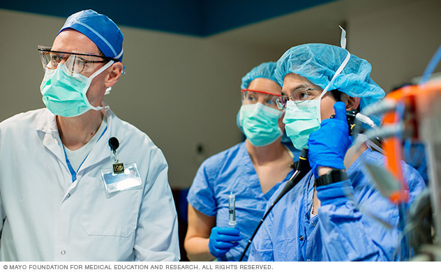 Mayo Clinic faculty member and residents conducting a procedure in operating room