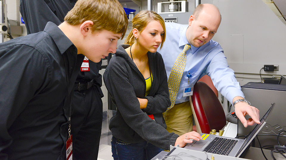 Photo of students reviewing data with a Mayo researcher