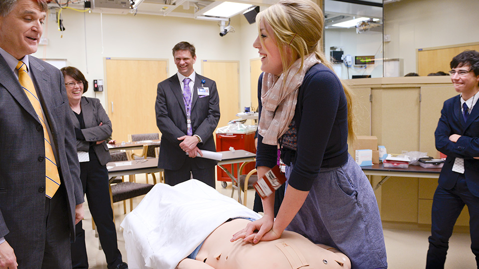 Photo of student performing CPR in the Mayo Clinic Multidisciplinary Simulation Center