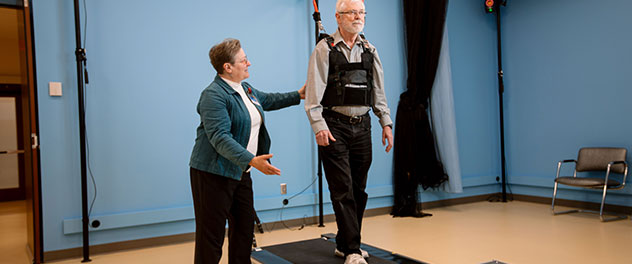 Picture of an older man walking on treadmill in the Motion Analysis Lab at Mayo Clinic.