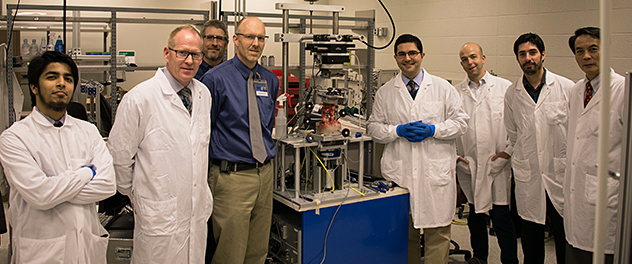 Neuroinformatics Lab researchers pose for a photo next equipment from the biomechanics team.
