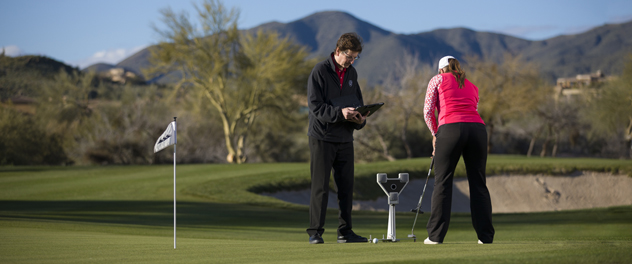 Dr. Adler works with a golfer with the yips at a local golf course in Phoenix.