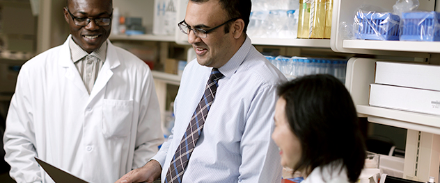 Image of three Mayo Clinic physicians collaborating.