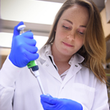 A student uses a pipette in a laboratory in the Department of Immunology at Mayo Clinic.