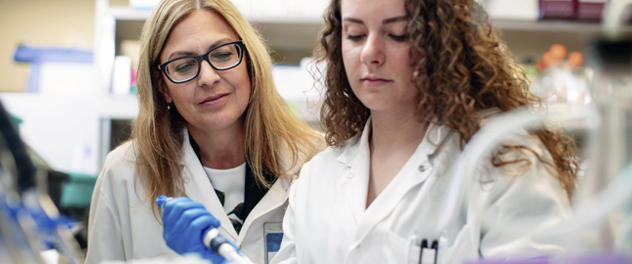 Dr. Karen Hedin supervises a laboratory trainee in the Department of Immunology at Mayo Clinic.