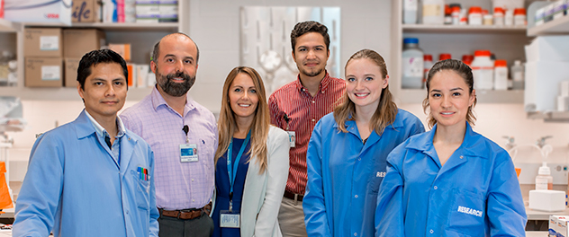 Dr. Guerrero Cazares pictured with team members in his Neurogenesis and Brain Tumors Lab at Mayo Clinic