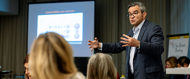 Picture of Dr. Victor M. Montori, M.D., leading a discussion about health care solutions