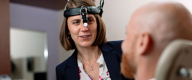 Dr. Janalee Stokken with patient in the Thyroid Eye Disease Clinic