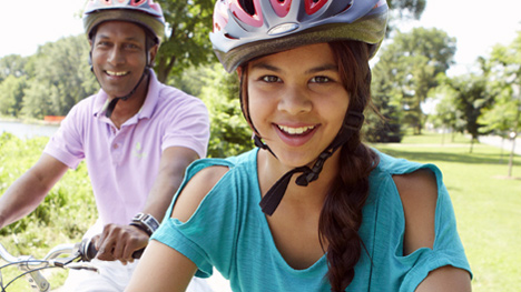 Photo of two people riding bikes