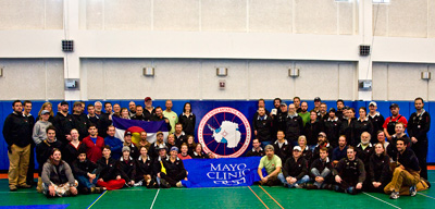 2007 Study Updates/Photos - Study volunteers holding the Mayo flag in the South Pole station gym.