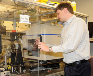 James R. Thompson, Ph.D., core director, mounting a frozen protein crystal on the goniometer of an X-ray diffractometer.
